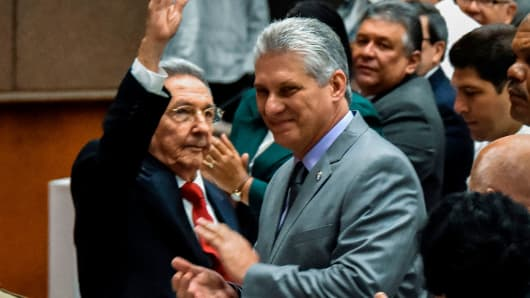 Cuban President Raul Castro (L) waves next to First Vice-President Miguel Diaz-Canel (C) during a National Assembly session that will select Cuba's Council of State ahead of the naming of a new president, in Havana on April 18, 2018.