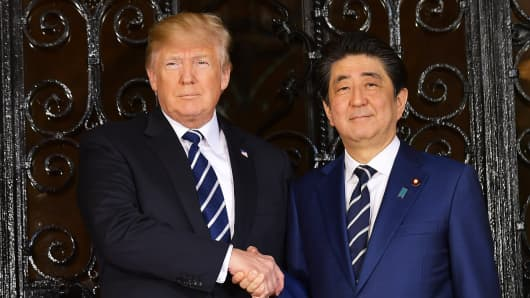 President Donald Trump greets Japanese Prime Minister Shinzo Abe as he arrives for talks at Trump's Mar-a-Lago resort in Palm Beach, Florida, on April 17, 2018.