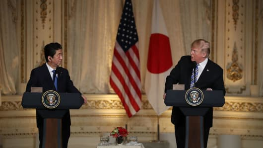 U.S. President Donald Trump and Japanese Prime Minister Shinzo Abe hold a news conference at Mar-a-Lago resort on April 18, 2018.
