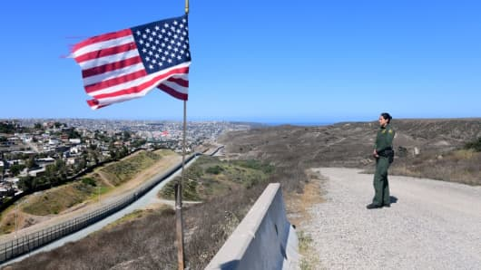 U.S. Customs and Border Protection agent Tekae Michael stands at a lookout point on April 17, 2018 in San Diego, California.