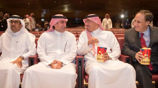 Saudi Minister of Culture and Information Awwad Alawwad (2nd R) and Vice President of AMC Jason Cole (R) attend the opening ceremony of the AMC Entertainment Cinema in the King Abdullah Financial District, Riyadh, Saudi Arabia on 18 April 2018.