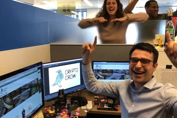 Crypto Crow, LLC founder and CEO Zack Guzman celebrates the launch of CryptoCrow.co with his CNBC Make It coworkers.