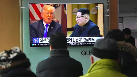 A television news report showing pictures of President Donald Trump and North Korean leader Kim Jong Un at a railway station in Seoul on March 9, 2018.