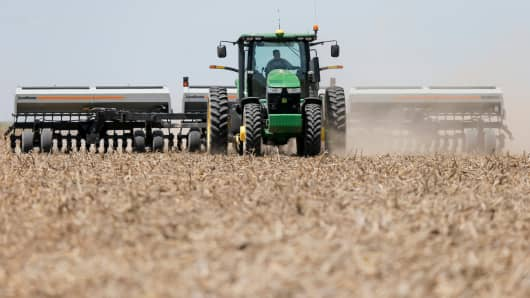 A farmer plants sorghum on his farm in Stanton County, Kan.