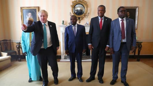 U.K. Foreign Secretary Boris Johnson (2nd L) poses for a photograph before talks with his Zimbabwean counterpart Sibusiso Moyo (C) and other delegations at the Commonwealth Heads of Government Meeting in London, U.K., on April 20, 2018.