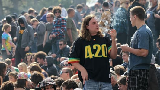 A marijuana user smokes marijuana during a 420 Day celebration on 'Hippie Hill' in Golden Gate Park in San Francisco, California. April 20th has become a de facto holiday for marijuana advocates, with large gatherings and 'smoke outs' in many parts of the United States.