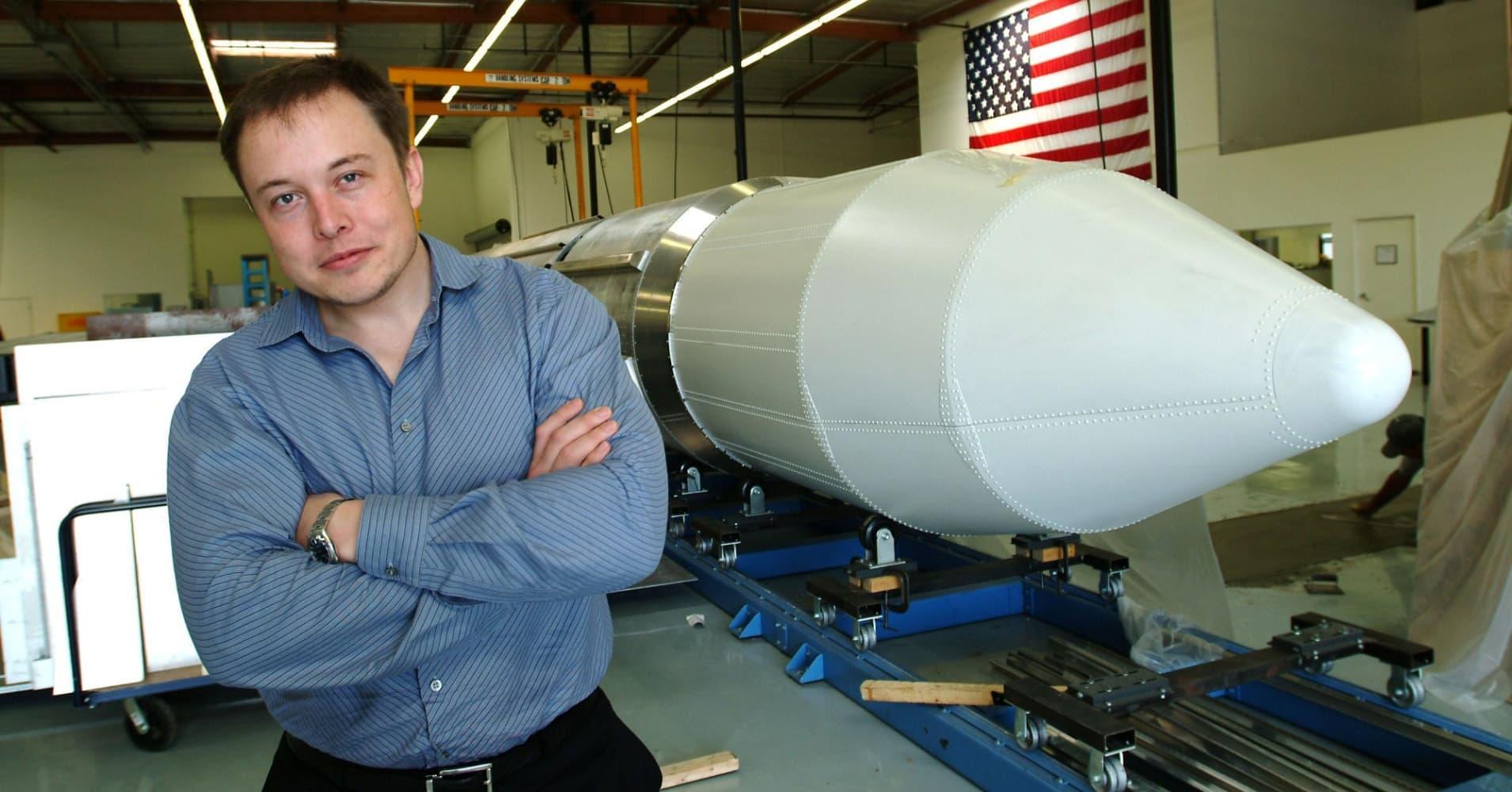 Elon Musk stands beside a rocket March 19, 2004 in El Segundo, Los Angeles, California.