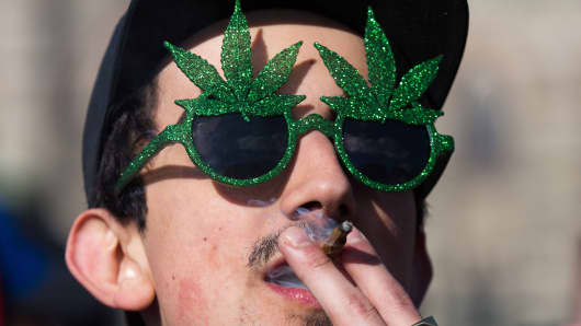 A man smokes marijuana during the annual 4/20 rally.