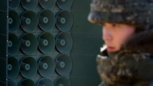 A South Korean soldier stands next to the loudspeakers near the border area between South Korea and North Korea on January 8, 2016 in Yeoncheon, South Korea.