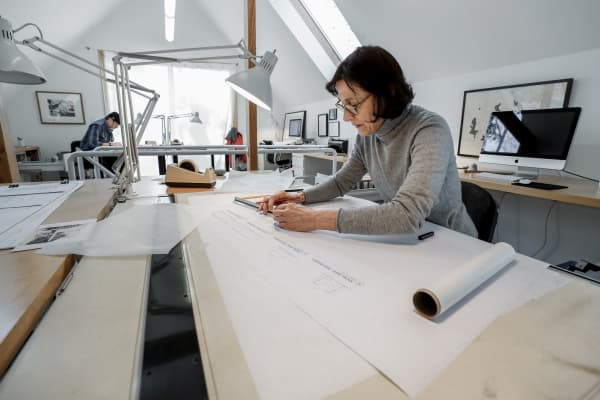Architect Carol Wilson works in her office.