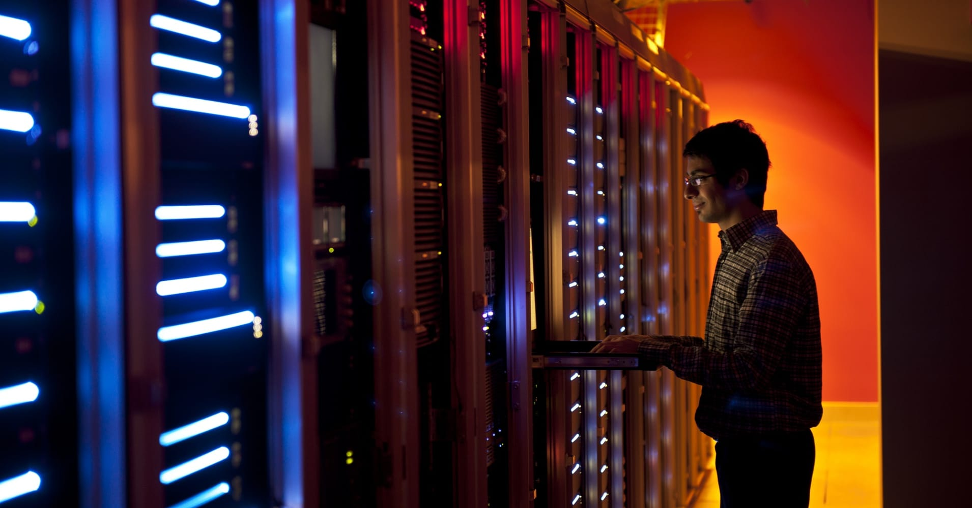 Systems engineer configuring servers in data center.