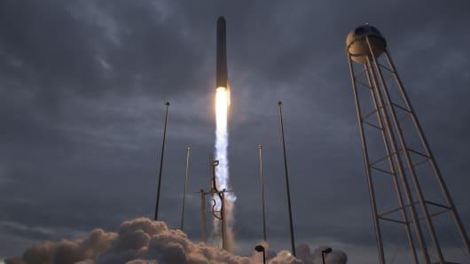An Orbital ATK Antares rocket launches from Pad-0A on November 12, 2017 at NASA's Wallops Flight Facility