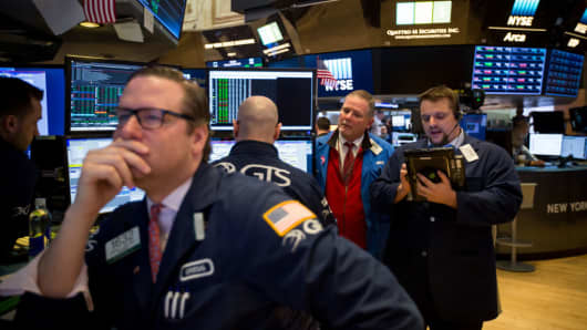Traders work on the floor of the New York Stock Exchange (NYSE) in New York, U.S., on Monday, April 23, 2018.