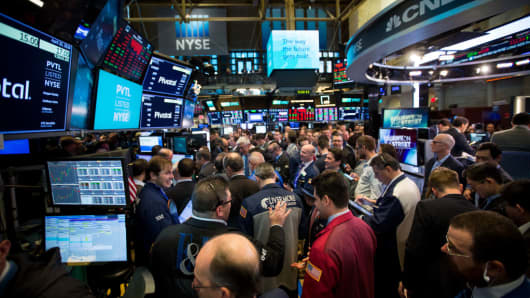 Traders work during the Pivotal Software Inc. initial public offering (IPO) on the floor of the New York Stock Exchange (NYSE) in New York, U.S., on Friday, April 20, 2018.