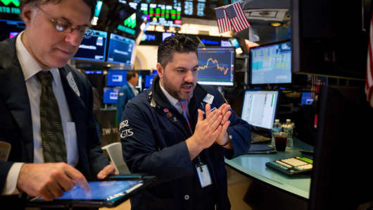 Traders work on the floor of the New York Stock Exchange (NYSE) in New York, U.S., on Friday, April 13, 2018.