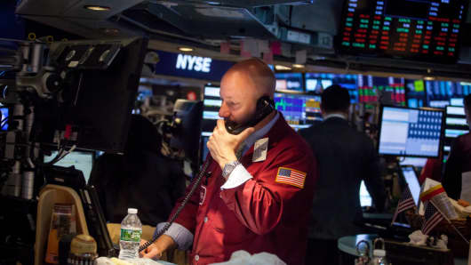 A trader works on the floor of the New York Stock Exchange (NYSE) in New York, U.S., on Monday, April 23, 2018.