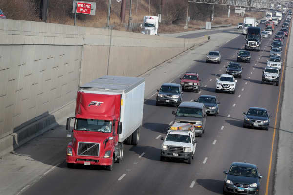 A truck drives out of the city on Interstate 55 on January 25, 2018 in Chicago, Illinois.