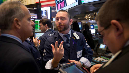 A trader gestures while working on the floor of the New York Stock Exchange (NYSE) in New York.