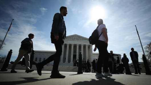 People wait in line to enter the U.S. Supreme Court in Washington, DC.