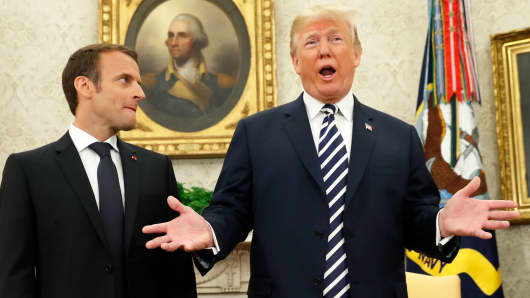 French President Emmanuel Macron (L) looks on as U.S. President Donald Trump speaks during their meeting in the Oval Office at the White House in Washington, April 24, 2018.