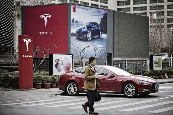 A Tesla Motors Model S electric automobile at one of the company's electric charging stations in Beijing on March 9, 2016.