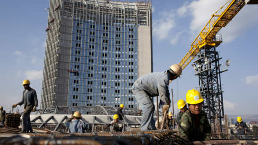 Chinese construction workers build the new African Union building on November 17, 2010, in Addis Ababa, Ethiopia.