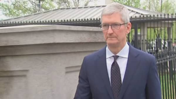 Apple CEO Tim Cook arrive at the White House