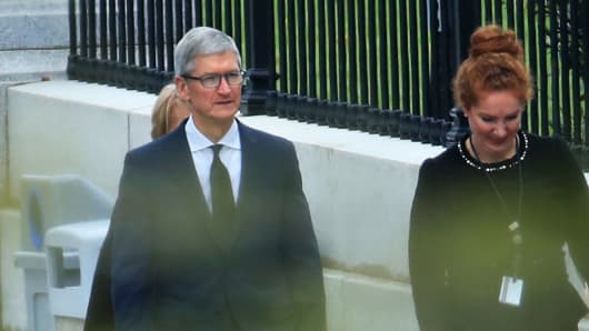 Apple CEO Tim Cook walks to the White House in Washington, Wednesday, April 25, 2018.