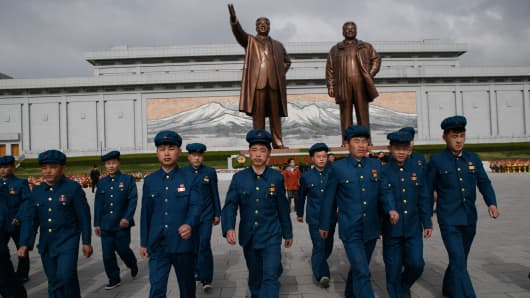 Pyongyang, April 15, 2018: Members of a North Korean youth league before the statues of late North Korean leaders Kim Il Sung and Kim Jong Il.