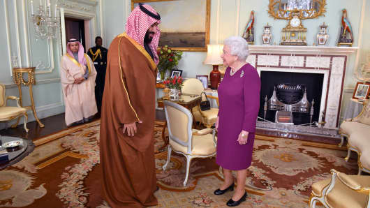 Queen Elizabeth II greets Mohammed bin Salman, the Crown Prince of Saudi Arabia, during a private audience at Buckingham Palace on March 7, 2018 in London.