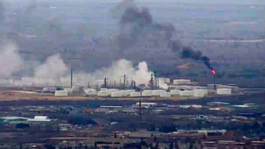 This image from video provided by WDIO-TV in Duluth shows smoke rising from the Husky Energy oil refinery after an explosion Thursday morning, April 26, 2018 in Superior, Wis.