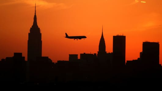 New York City skyline with plane.