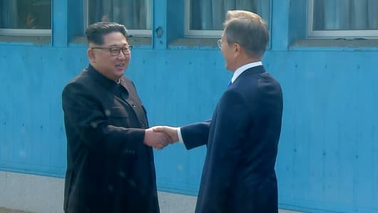 North Korean leader Kim Jong Un shakes hands with South Korean President Moon Jae-in as Kim crossed the border into South Korea for their historic face-to-face talks.