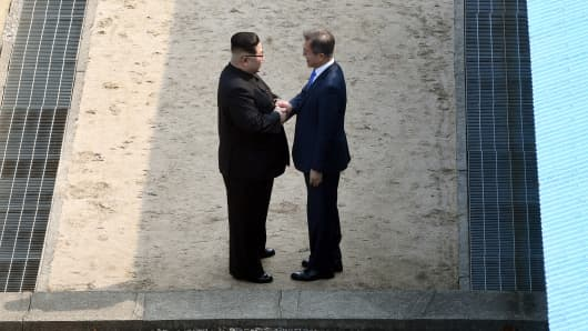 North Korean leader Kim Jong Un and South Korean President Moon Jae-in shake hands at the Inter-Korean Summit April 27, 2018 in Panmunjom, South Korea.