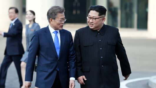 South Korean President Moon Jae-in and North Korean leader Kim Jong Un walk together at the truce village of Panmunjom inside the demilitarized zone separating the two Koreas, South Korea, April 27, 2018.