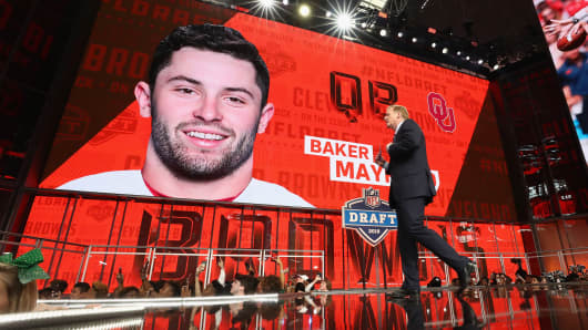 NFL Commissioner Roger Goodell walks past a video board displaying an image of Baker Mayfield of Oklahoma after he was picked #1 overall by the Cleveland Browns during the first round of the 2018 NFL Draft at AT&T Stadium on April 26, 2018 in Arlington, Texas.