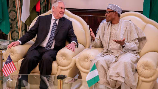 Then U.S. Secretary of State Rex Tillerson (L) and Nigerian President Muhammadu Buhari in Abuja, Nigeria, on March 12, 2018.