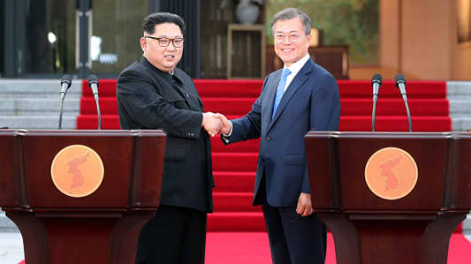 North Korean leader Kim Jong Un (L) and South Korean President Moon Jae-in (R) shake hands after announcing the Panmunjom Declaration for Peace, Prosperity and Unification of the Korean Peninsula during the Inter-Korean Summit in front of the Peace House on April 27, 2018 in Panmunjom, South Korea. Kim and Moon meet at the border today for the third-ever Inter-Korean summit talks after the 1945 division of the peninsula, and first since 2007 between then President Roh Moo-hyun of South Korea and Leader Kim Jong-il of North Korea.