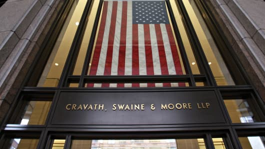 An American flag hangs over the entrance to the law offices of Cravath Swaine & Moore LLP in New York.