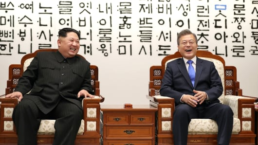 South Korean president, Moon Jae-in (R) and North Korean leader Kim Jong-un (L) are hugging after issuing a joint statement in the Peace House building at the southern side of the truce village of Panmunjom, South Korea on April 27, 2018.