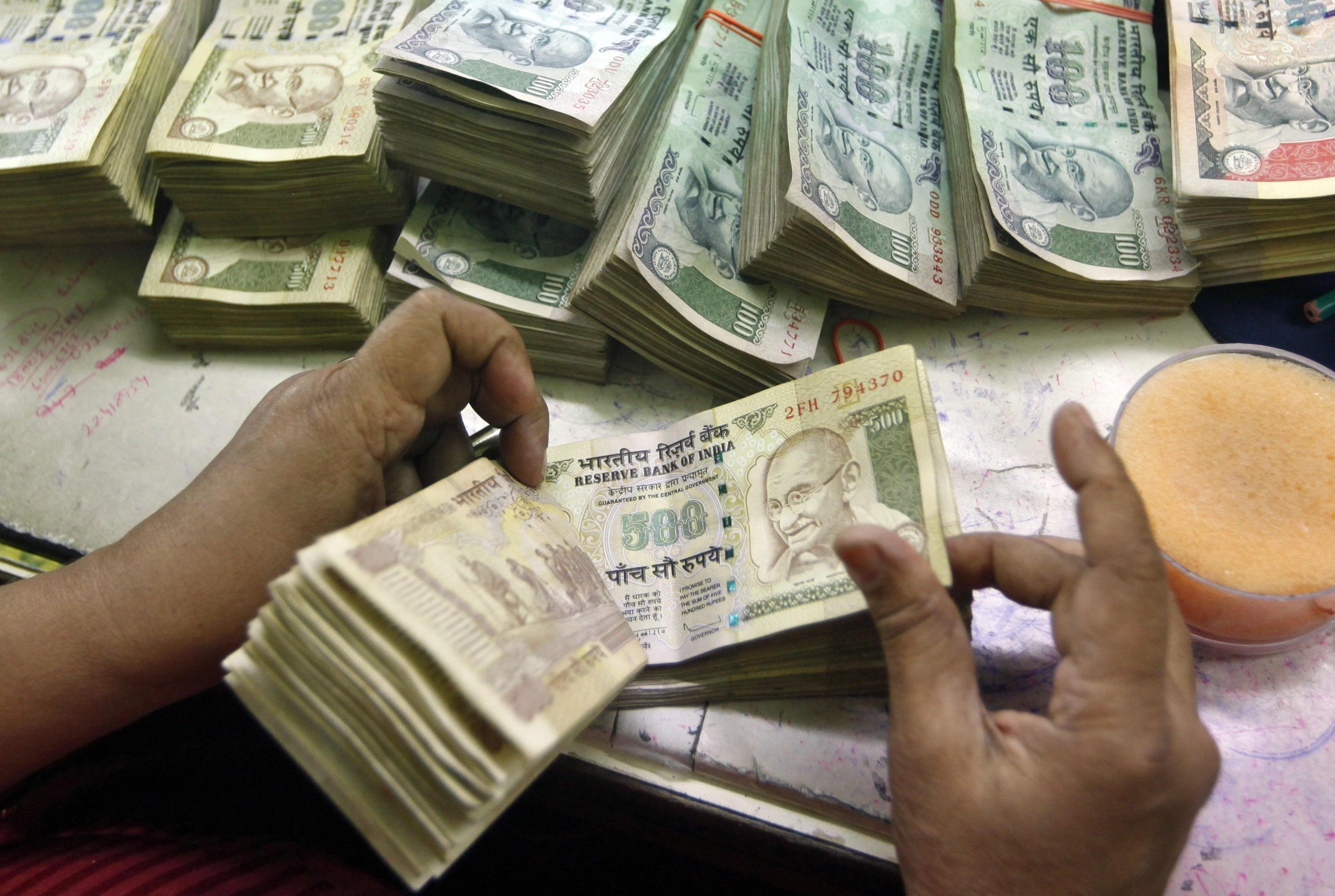 Indian Rupee Hits Record Low Rbi Seen To Have Intervened