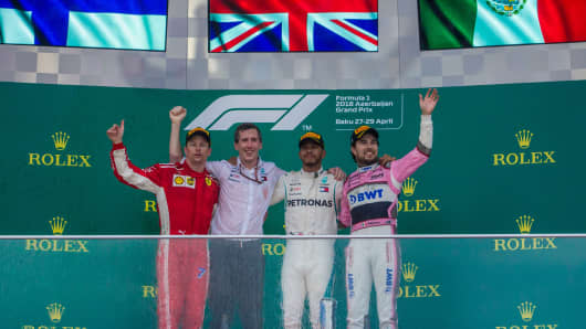 The winners 1st Lewis Hamilton, 2nd Kimi Räikkönen and 3rd Sergio Perez on the podium during the award ceremony at Azerbaijan Formula 1 Grand Prix on Apr 29, 2018 in Baku, Azerbaijan
