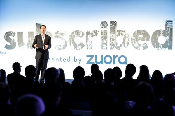 Zuora CEO Tien Tzuo on stage.