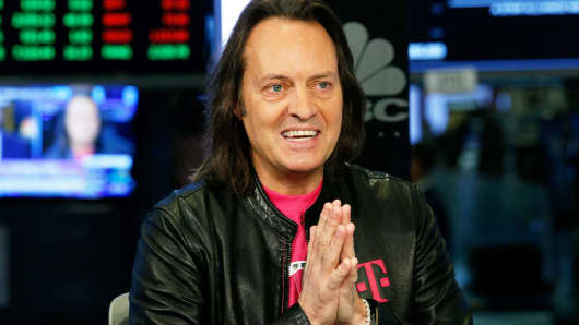 T-Mobile CEO John Legere speaks on the floor of the New York Stock Exchange, April 30, 2018.