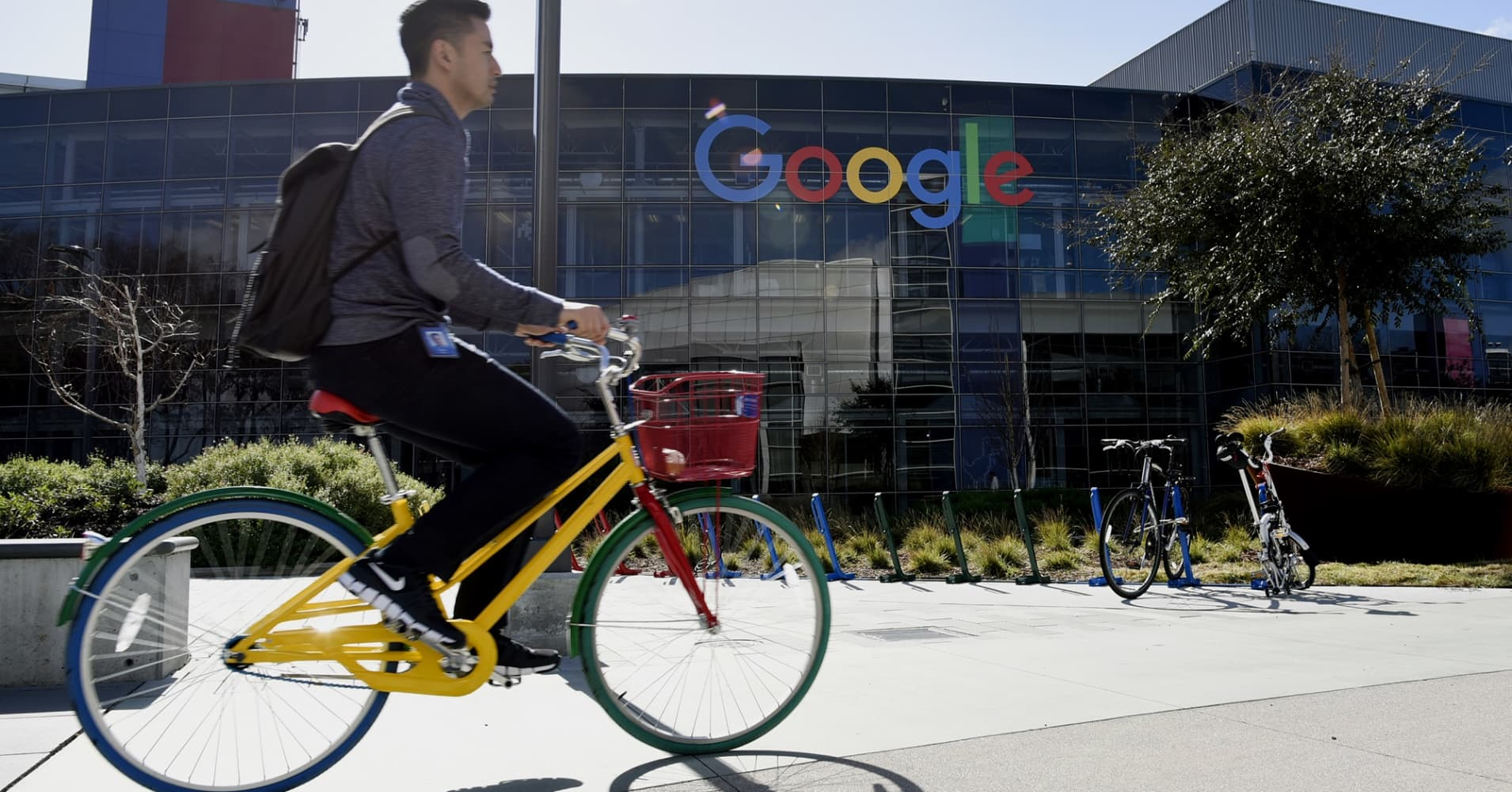 A cyclist rides past Google Inc. offices inside the Googleplex headquarters in Mountain View, California.