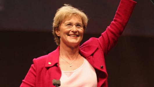 Then-National Rifle Association First Vice-President Sandra Froman waves to the crowd after making remarks during opening ceremonies of the NRA's national meeting April 15, 2005 in Houston.