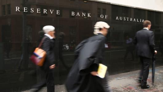Pedestrians walk past the Reserve Bank of Australia (RBA) headquarters in Sydney, Australia.