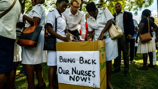 People cast letters of complaint to Zimbabwe's Vice President Constantino Chiwenga in Harare's Unity Square on April 20, 2018, after thousands of nurses were dismissed in a dispute over pay.