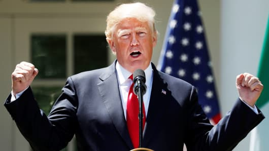 President Donald Trump gestures while addressing a joint news conference with Nigeria's President Muhammadu Buhari in the Rose Garden of the White House in Washington, U.S., April 30, 2018.