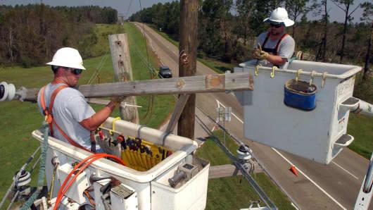 Utilities workers helping restore power near Mobile, Alabama.